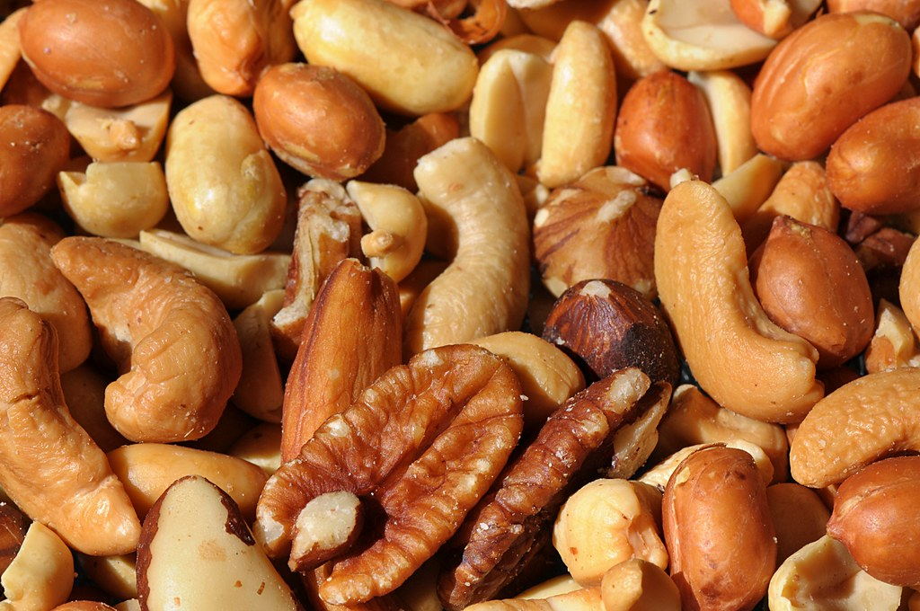 pile of almonds, cashews, pecans and peanuts