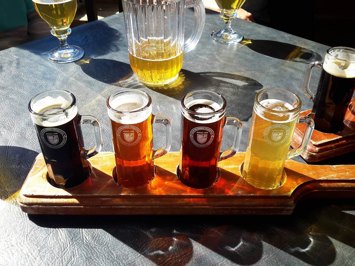 beer flight on a table in the sun