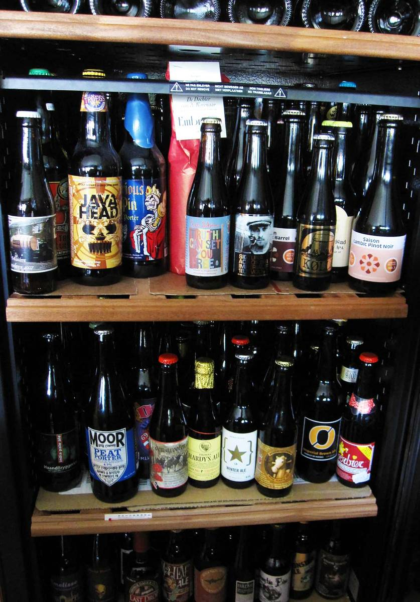 collection of beer on shelves in a beer cellar