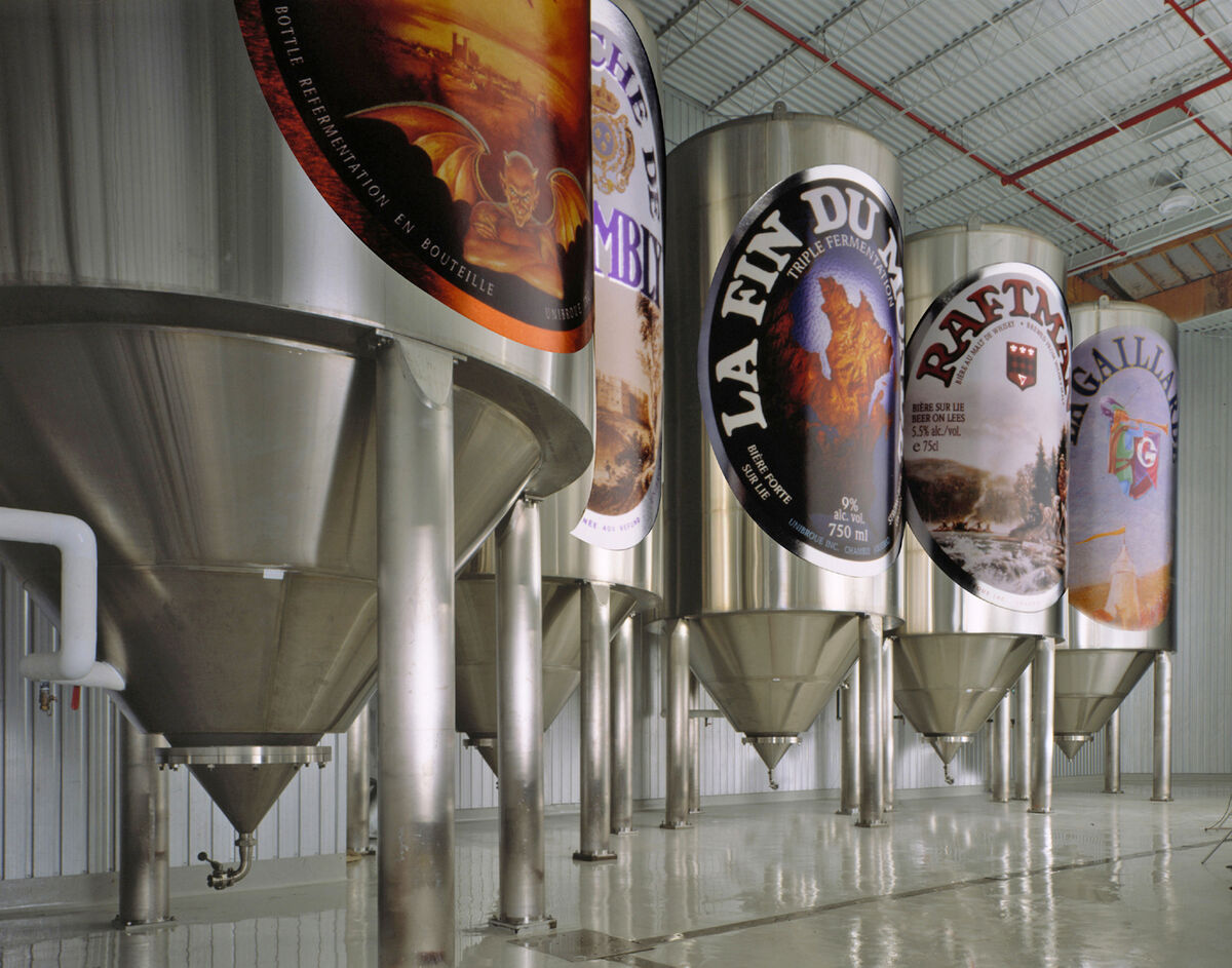 unibroue fermentation tanks with label artwork