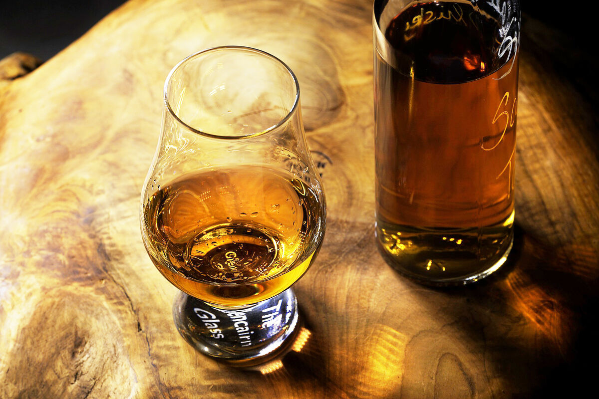 attractive whiskey glass on wooden table