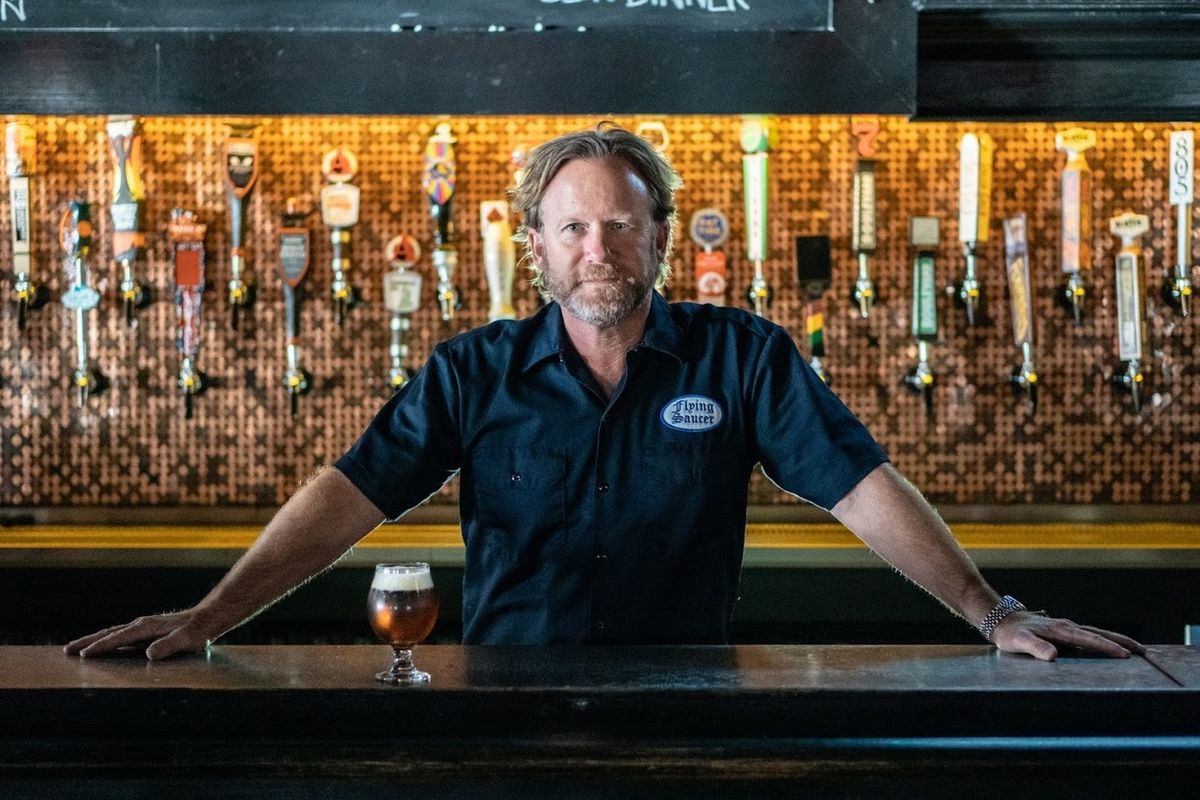 keith schlabs stands behind flying saucer draught emporium bar