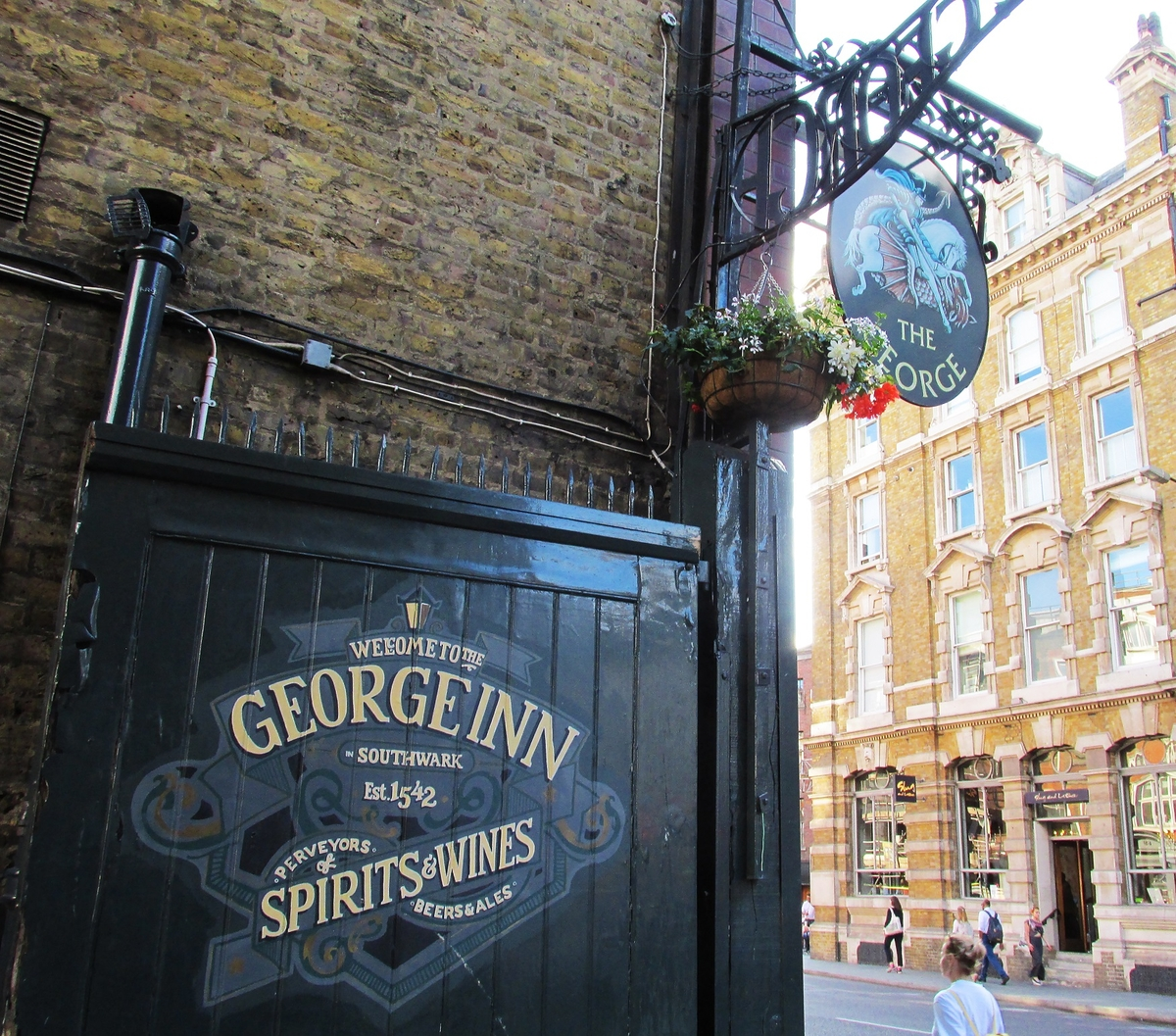 the george inn street sign and entrance gate