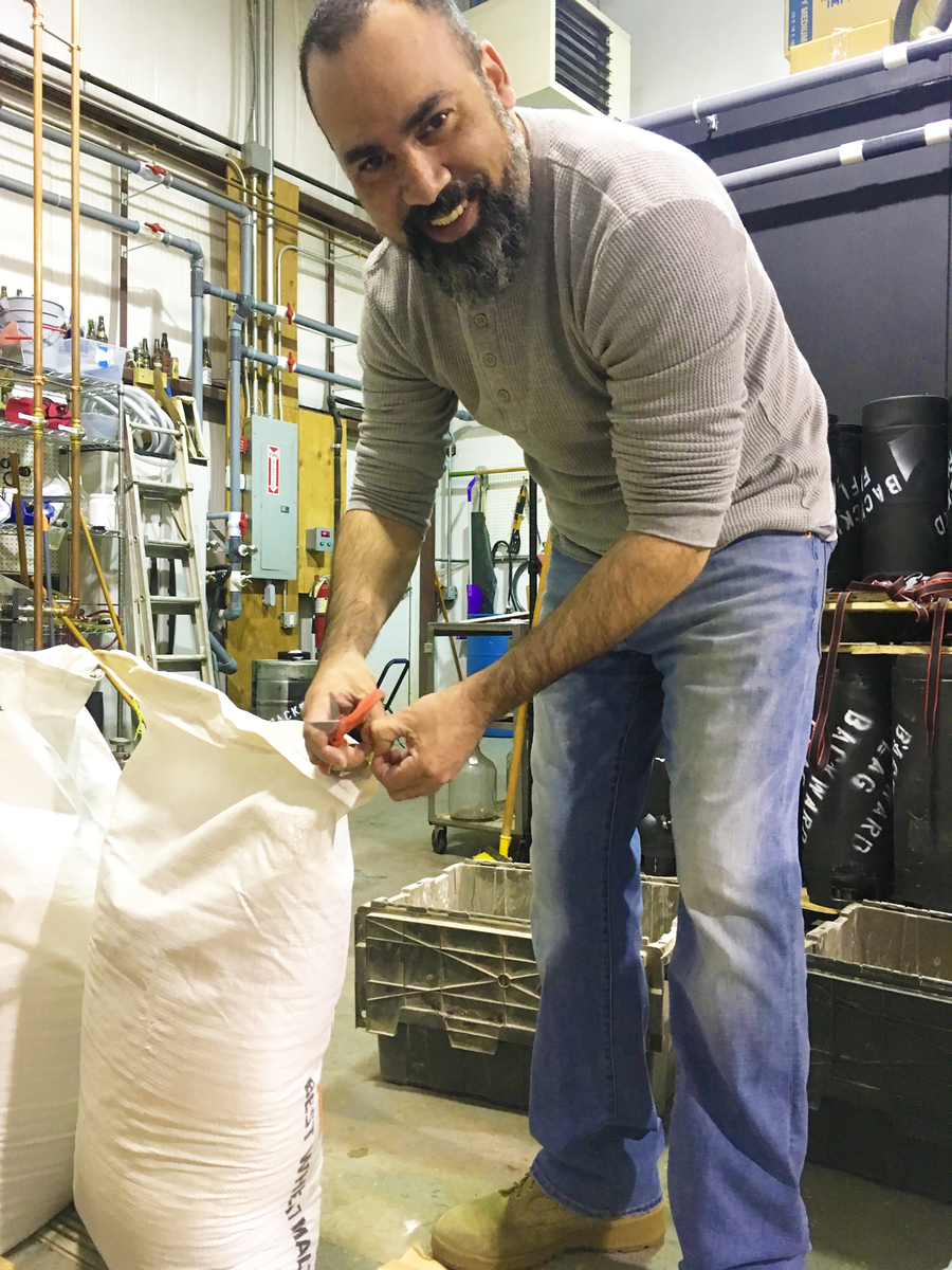 jose miranda working in the brewhouse thanks to arms to artisans