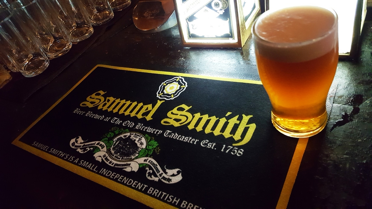 samuel smith's old brewery bitter sitting on a branded bar mat