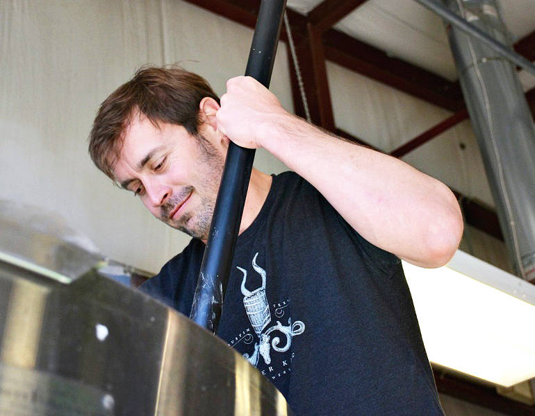 Stuffings stirs the mash. (Photo Courtesy of Jester King Brewery)