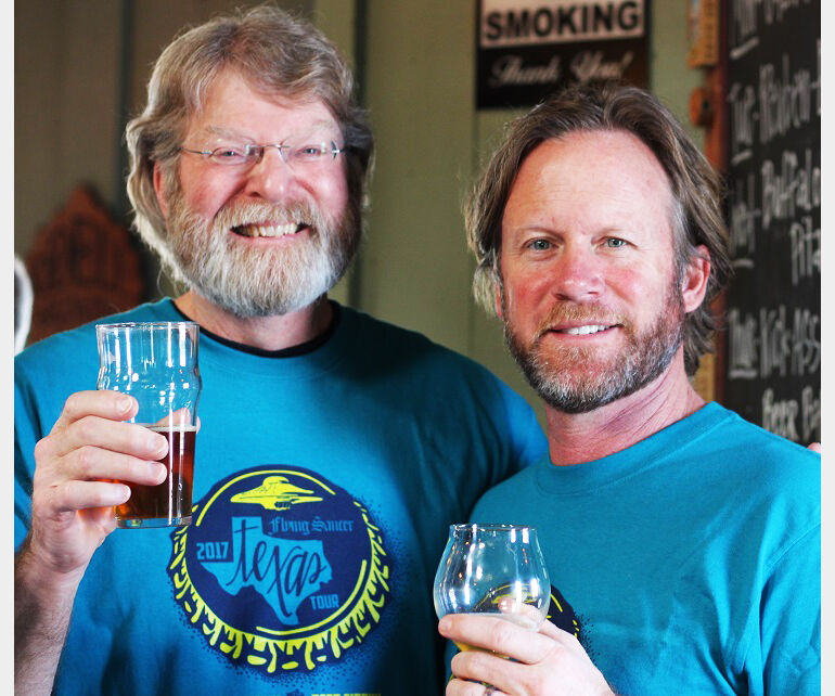 Mike Hagan of Mike-Ro-Brewery and Keith Schlabs of Flying Saucer hoist a glass to craft beer in 2017.