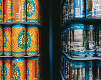 Oberon and Winter White cans.