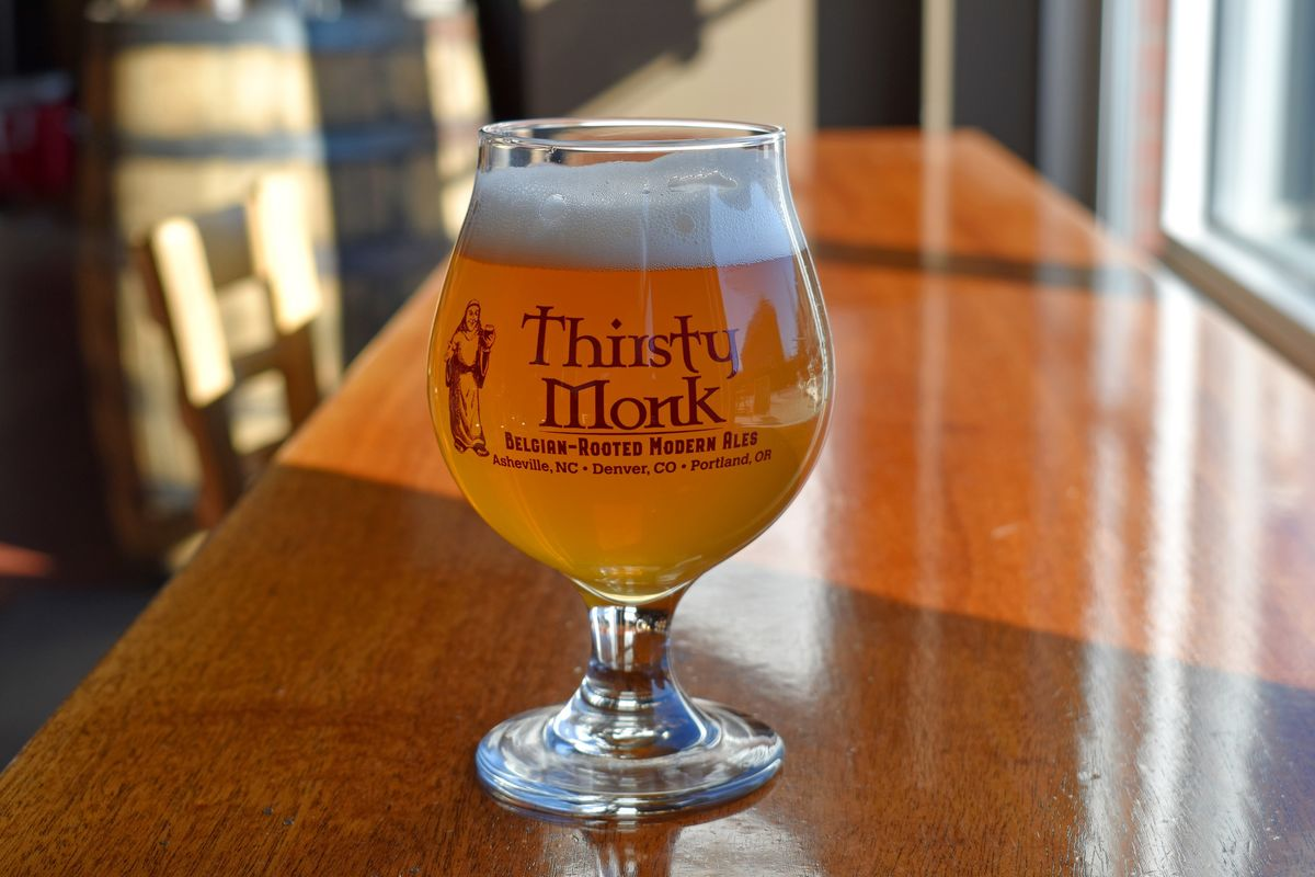 thirsty monk branded glassware on a table