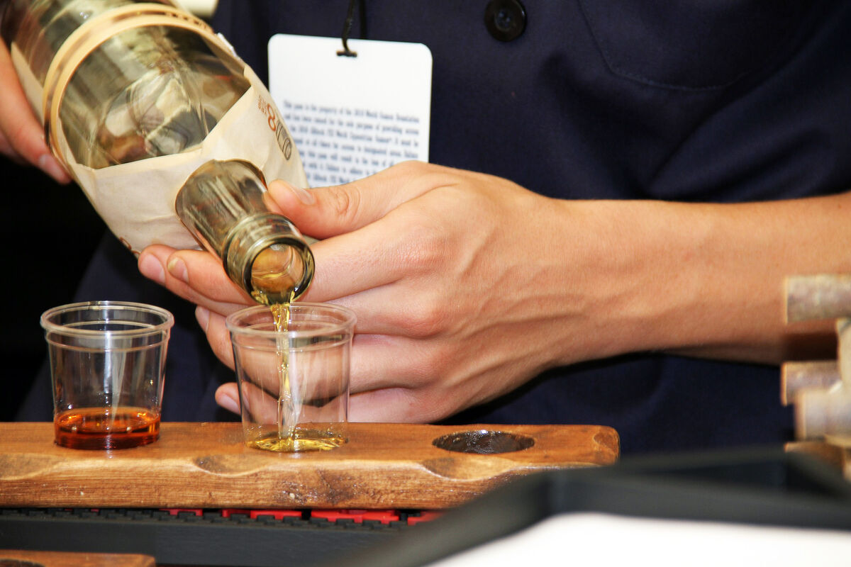 whiskey being poured for tasting